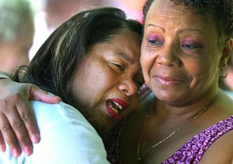 Kim Odom wept on the shoulder of her friend Joyce Neale as the Steven Odom Tranquility Garden in Dorchester was dedicated to the memory of her son. The Odoms have become involved in antiviolence advocacy.